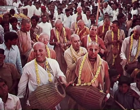 Srila Prabhupada's Western devotees chanting at a Hare Krishna sankirtana festival in India. 1975.