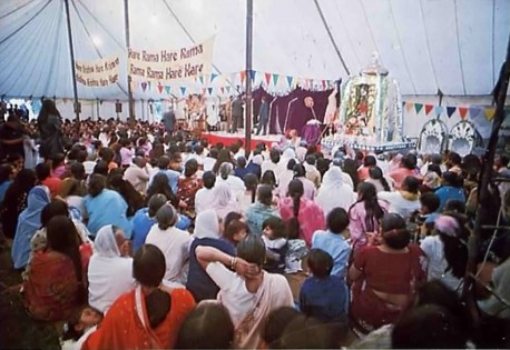 Indian guests enjoy cultural program in large tent at Bhaktivedanta Manor. 1975.