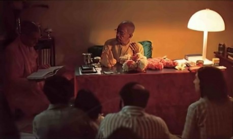 Srila Prabhupada with guests and discipels for evening study session. 1975.