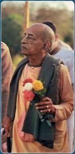Srila Prabhupada holding a bunch of roses. 1976