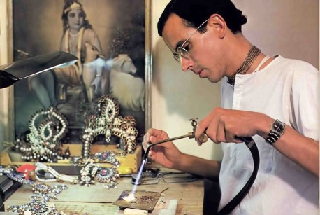 Hare Krishna devotee making jewelery for Radha Krishna deities. 1976.