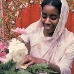 ISKCON devotee makes flower arrangements for offering to the Deities at Hare Krishna Temple. 1976.