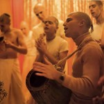 ISKCON Devotees Chant Hare Krishna during aroti in temple. 1976.