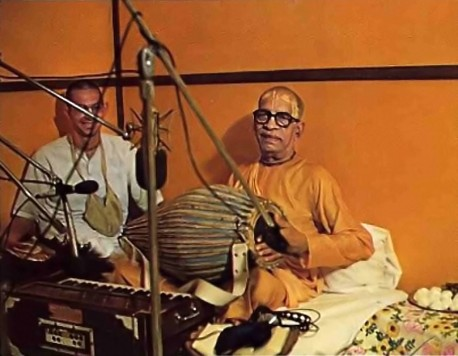 At Golden Avatar recording studios, in Los Angeles, Prabhupada plays the mrdanga and chants the Hare Krishna mantra. 1976 Summer Tour.