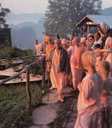 Residents of the New Vrindavan farm community greet Sri/a Prabhupada during an early morning walk. 1976 Summer Tour.