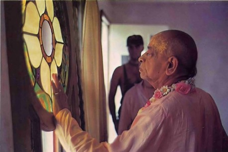At a New Vrindavan construction site, Srila Prabhupada looks at a stained glass window. Summer Tour 1976.