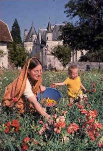 Woman devotee and her son picking flowers at New Mayapur, ISKCON's farm in France.