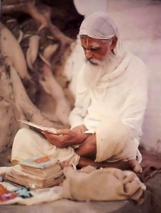 Pundit studying the scriptures in Indian Village 1976.