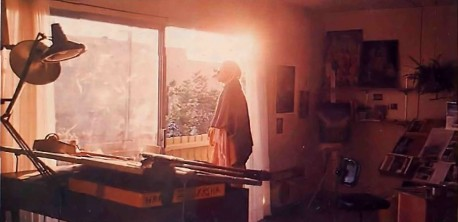 an artist meditates on the Hare Krishna mahamantra before he begins a day of painting.