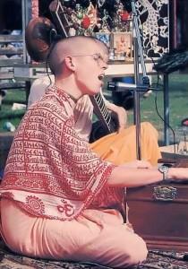 Adi-Kesava Swami chants Hare Krishna at a festival in Gainesville, Florida. - 1977
