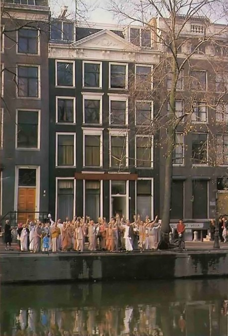 ISKCON Devotees standing before the Amsterdam center of the International Society for Krishna Consciousness. 1977