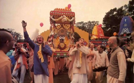 Lord Jagannatha takes a palanquin ride to the dais; from there He can cherish the sights and sounds of thousands chanting Hare Krishna and feasting on prasada. - 1977