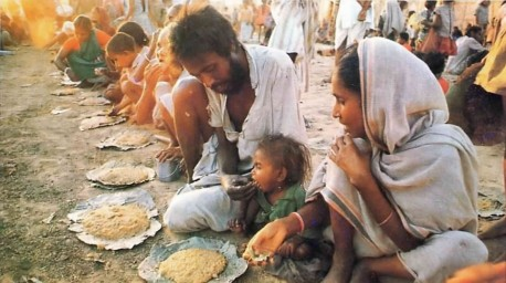 ISKCON Devotees feeding hungry people at Mayapur, West Bengal, 1977.