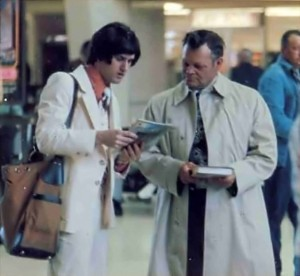 ISKCON Hare Krishna Book Distributor with wig selling books in airport - 1977