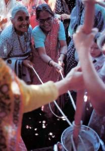 Indian Ladies Churning Butter at Bhaktivedanta Manor's Janmashtami Celebrations - 1977