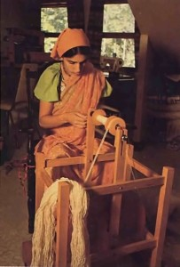 Mother Satyabhama spins wool into yarn at Gita-Nagari 1977