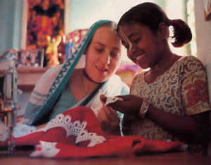 Sewing clothes for the Deities is the way some of the community members (as above) take pleasure in serving the Lord.