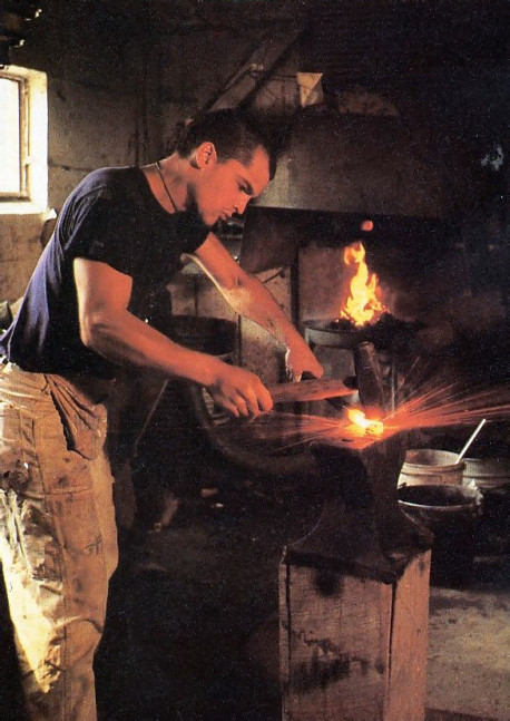 Sparks fly in the wrought-iron shop as a devotee makes gates for the Palace