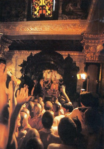 """Devotees cheer as the inner doors open upon the figure of Srila Prabhupada. """"It's very nice,"""" says Srila Bhaktipada, """"when we have guests come and they look all around the Palace and admire how nice it is. And when they see Prabhupada and say, 'This is the best thing ,' then we feel like we've been successful."""""""