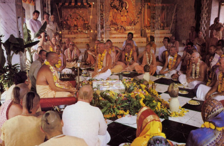 Inotiation into Krsna consciousness takes place during a joyful ceremony. At left. His Divine Grace Bhavananda Goswami Visnupada initiates disciples at a temple devotees recently constructed at their New Govardhana farm in New South Wales.