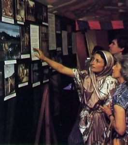 Above, a festival-goer learns of ISKCON's farm projects at one of several photo displays.