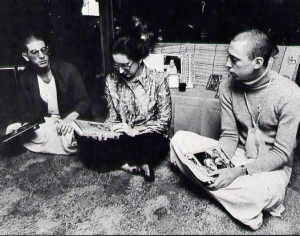 Mrs. Redfield sits in her living room in Boise with her son Jagannatha Puri dasa (at left) and his friend Jyotindra dasa.
