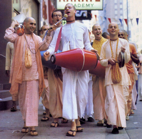 The recommended yoga for this age: chanting t he holy names of God. City living affords little facility for the strict practice of physical yoga. Chanting Hare Krsna, however, is the foundation of the highest yoga yet can be executed anywhere. any time . Left. devotees from the New York City temple bring the Hare Krsna mantra to Broadway.