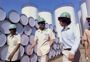 While inspecting his Trombay oil refinery, at left, Nathji explains plant facilities to a visitor.