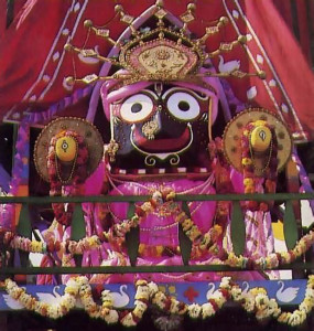 Lord Jagannatha, the center of worship, beams from the main chariot in a recent festival in Boston.