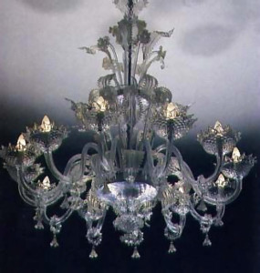 A lotus-shaped crystal chandelier with dew drop pendants. Marco designed the bookcase for the Krsna asrama in Valencay. France.