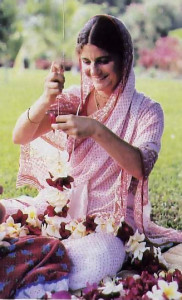 stringing a garland in Hawaii