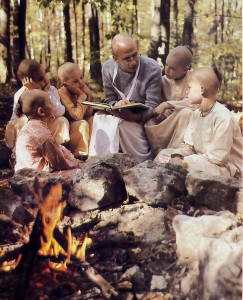 Bhurijana and the boys enjoy a story about Krsna playing in the woods with His cowherd friends