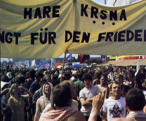 """Hare Krsna Sings for Peace"" amid a crowd of marchers in Bonn during President Reagan's visit"