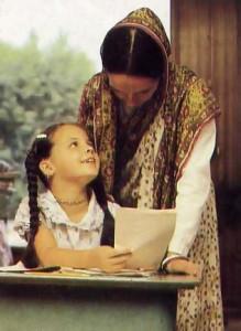 Nirupama-devi dasi checks Mitra's spelling exercise.