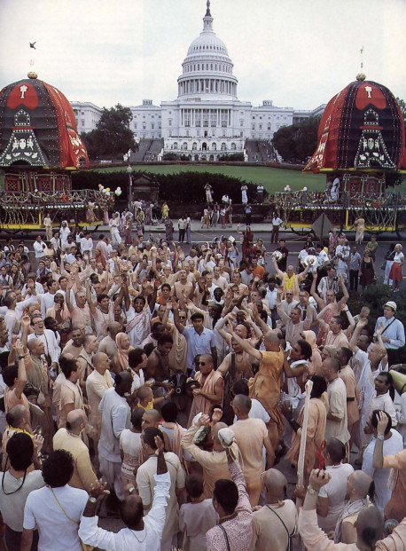 one of the leaders of the Hare Krsna movement (His Holiness Prabhupada-krpa Goswami, at center with sunglasses) leads the devotees in a crescendo of chanting before the Capitol.