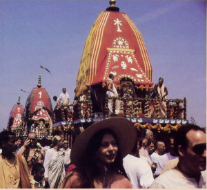 Festive summer crowds escort Lord .Krsna's chariot along Venice Beach in Los Angeles, California