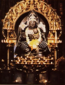 The Deity of Nrsimhadeva. Lord Krsna's form as half-man, half-lion, sits triumphantly on His throne in the Hare Krsna temple in West Germany's Bavarian Forest.