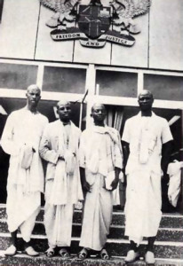 Before the Ghanian state house in Accra: (left to right) Raivata Muni dasa, Maha·mantra dasa, Jiva Goswami dasa, and Laksmi-pati dasa, delegates to the recent religious conference there
