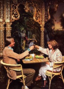 Two patrons toast each other's health with apple juice. The ornate columns and arches, as well as the mural depicting Krsna in the spiritual world, are all products of the devotees' own artistry