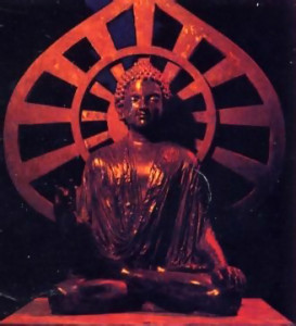 A figure of Lord Buddha they created sits under an ornate gazebo.