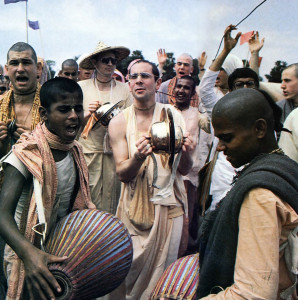 The sound of mrdanga drums and hand cymbals fills the air as devotees from East and West join Srila Ramesvara Swami (center) and Srila Harikesa Swami (with hat), two of ISKCON's present spiritual masters, in a joyous kirtana.