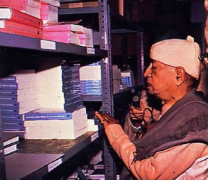 Srila Prabhupada inspects his book warehouse in Los Angeles. He inherited the Krsna conscious tradition as it came down from Srila Bhaktivinoda Thakura and Srila Bhaktisiddhanta Sarasvati.