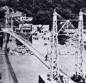 THE LAKSHMAN-JHULA FOOTBRIDGE WHICH ALL PILGRIMS TO RISHIKESH MUST CROSS. IT SPANS THE GANGES FROM THE CLIFFS OF LAKSHMAN-JHULA TO SWARGRASHRAM
