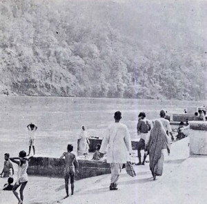 PILGRIMS REFRESH THEMSELVES IN THE COOL, SACRED WATERS OF THE GANGES.