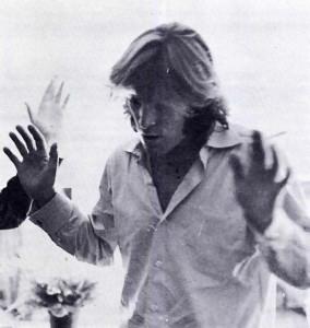 Denis Wilson dances to the chanting of Hare Krishna.