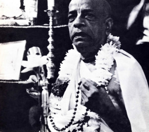 His Divine Grace A.C. Bhaktivedanta Swami sanctifies the japa beads of the new initiate.