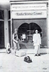 Shivananda das outside the display window with one of the friends of the temple before going out for Samkirtan.