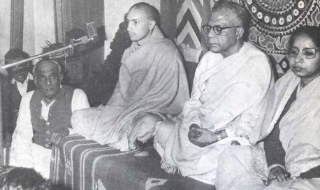 Sriman Acyutananda das Brahmacari, pictured at microphone, is now visiting Calcutta. We have there a every enthusiastic friend for preaching Krsna consciousness: Mr. B.K. Ghosh, M.A., LL.B., who is a great admirer of Caitanya philosophy, and is holding sankirtana meetings every Sunday in different places throughout Calcutta and suburbs. Recently at one meeting, Acyutananda was guest speaker on Krsna consciousness philosophy. Presiding was the Honorable Mr. P.B. Mukherjee, Justice of the Calcutta High Court, sitting to the left of Acyutananda. Gradually this nice center of the International Society for Krishna Consciousness is growing, with the prospect of headquaters at Mayapur, the birthsite of Lord Caitanya.
