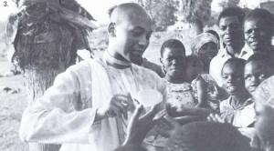 An American Hare Krsna devotee distributing prasadam, spiritual food.