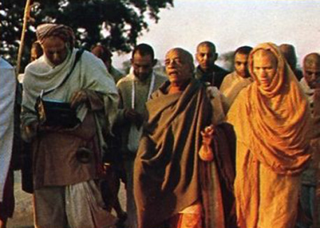 Srila Prabhupada leads disciples on an early morning walk in this transcendental land.